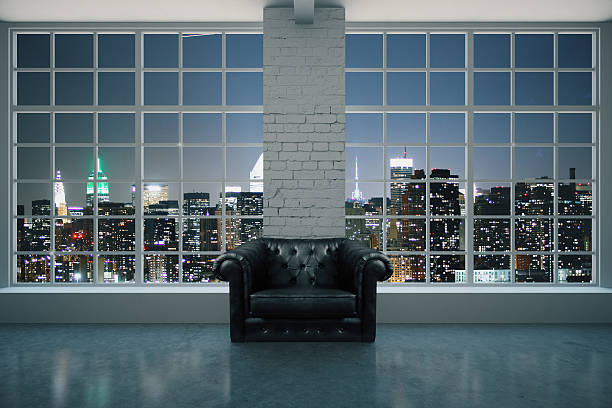 Black leather armchair in interior stock photo