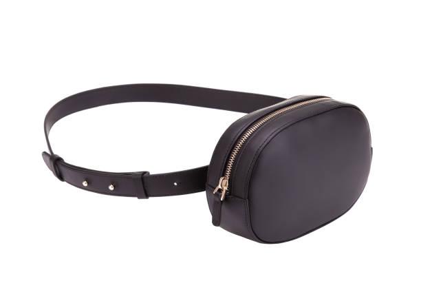 black leather belt bag. fashionable belt bag. - waist bag stock photos and pictures