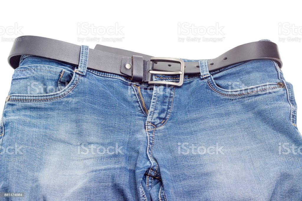 Black leather belt in belt loops of the blue jeans stock photo