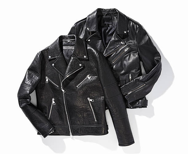 Black leather biker jackets Black leather biker jackets isolated on white background (with clipping path) leather jacket stock pictures, royalty-free photos & images