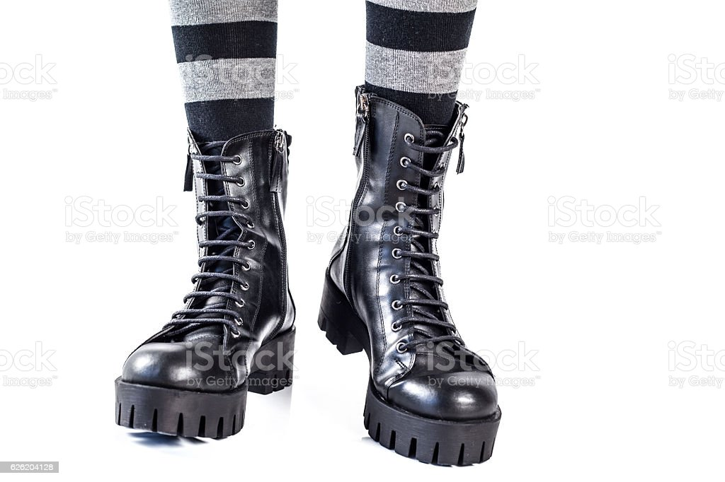 Black leather boots isolated on white background stock photo