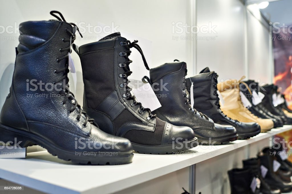 Black leather boots on shelf in store stock photo
