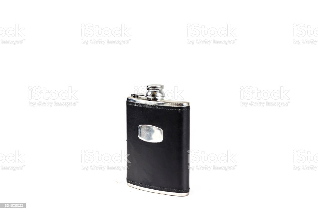 Black Leather covered hip flask with the lid closed stock photo
