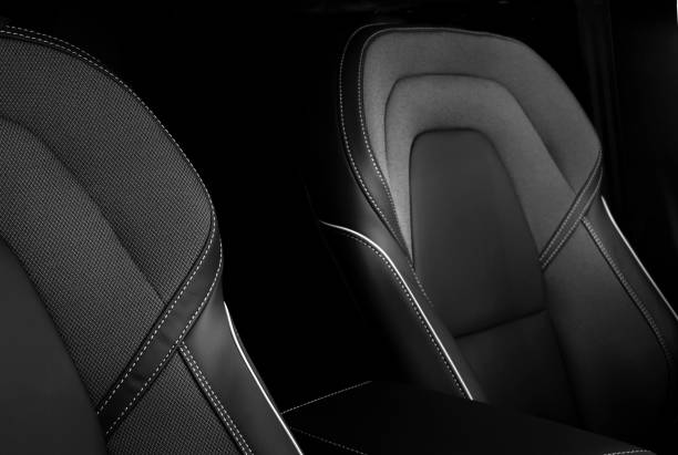 Black leather driver's and passenger's seat of a vehicle stock photo