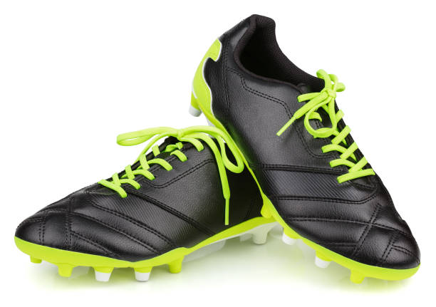 black leather football shoes or soccer boots isolated on white background Pair of new unbranded black leather football shoes or soccer boots isolated on white background with clipping path american football uniform stock pictures, royalty-free photos & images