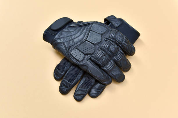 black leather gloves for riding a motorcycle or bicycle - sports glove stock photos and pictures