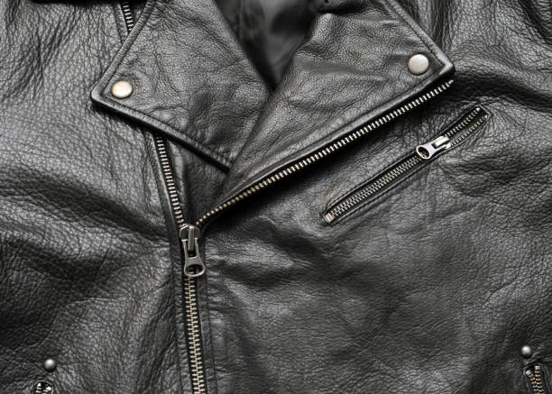 Black Leather Jacket Closeup of a mass produced, generic black leather jacket. leather jacket stock pictures, royalty-free photos & images
