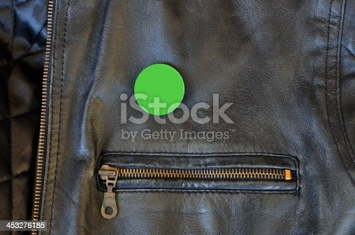Black leather jacket with zipper and blank pin badge to add your own text or logo.