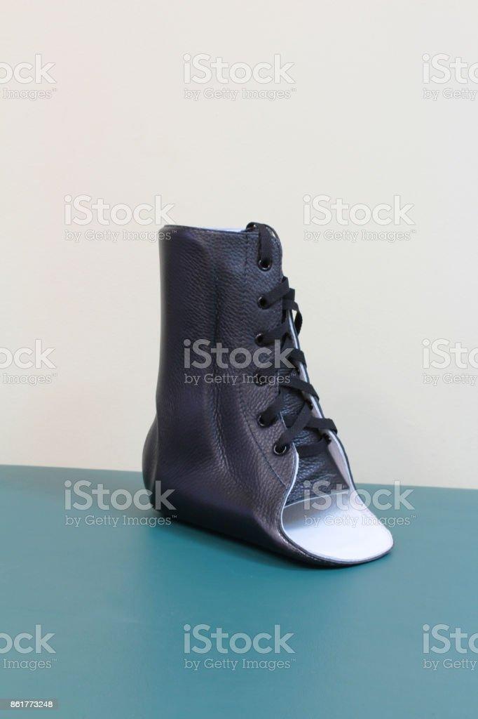 Black leather lace up ankle brace quarter turn stock photo