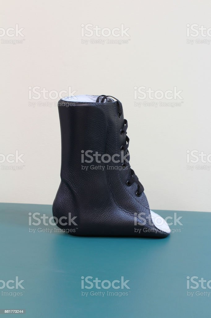 Black leather lace up ankle brace side view stock photo