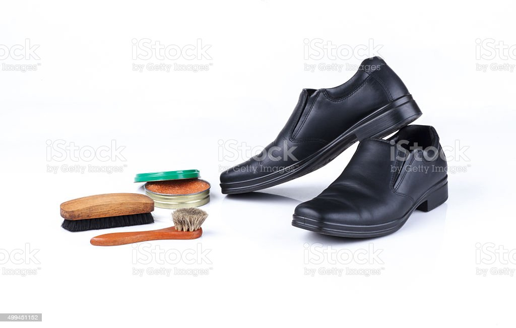 Black leather shoes and polish equipments stock photo