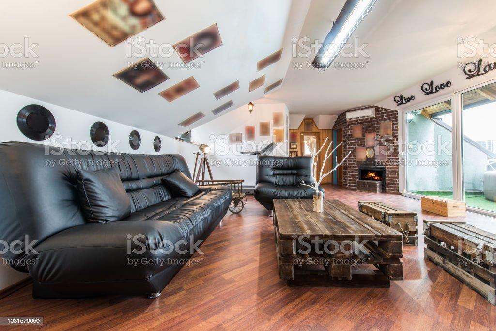 Black Leather Sofa In Loft Apartment Stock Photo - Download ...