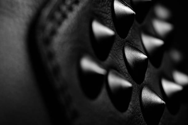 Black Leather Spikes A close-up of black leather spikes studded stock pictures, royalty-free photos & images