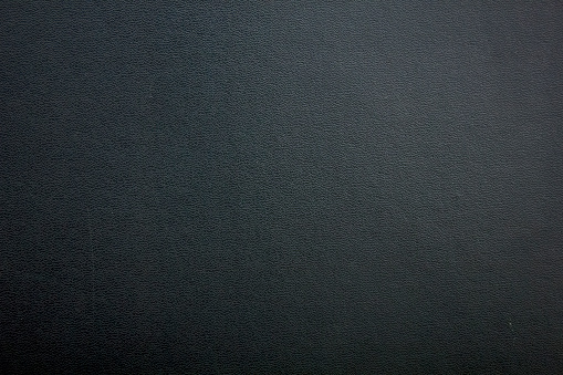 Rugged texture of black synthetic leather.