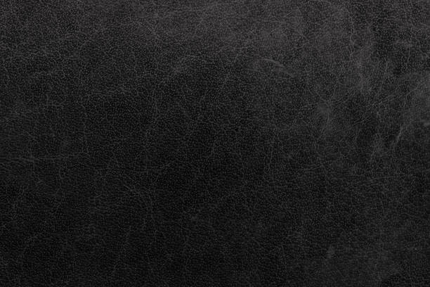 Black leather texture Black leather texture cowhide stock pictures, royalty-free photos & images