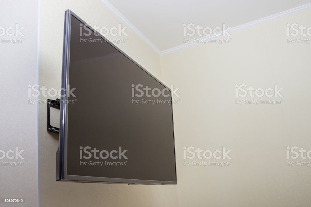 Black LED tv television screen mockup mock up, blank on white wall background stock photo