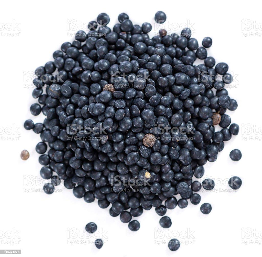 Black Lentils (isolated on white) stock photo