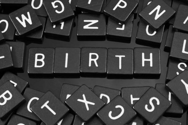 Black letter tiles spelling the word 'birth' stock photo
