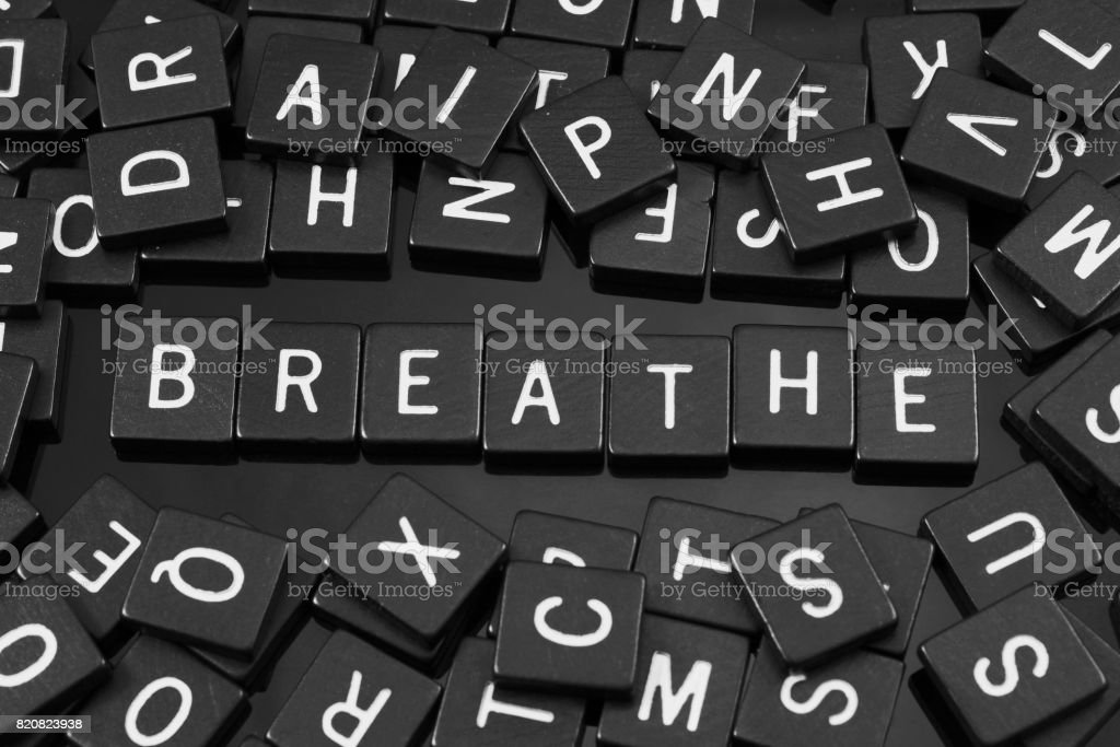 Black letter tiles spelling the word 'breathe' stock photo