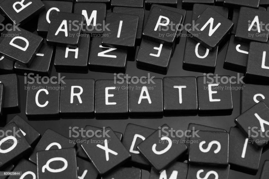 Black letter tiles spelling the word 'create' stock photo