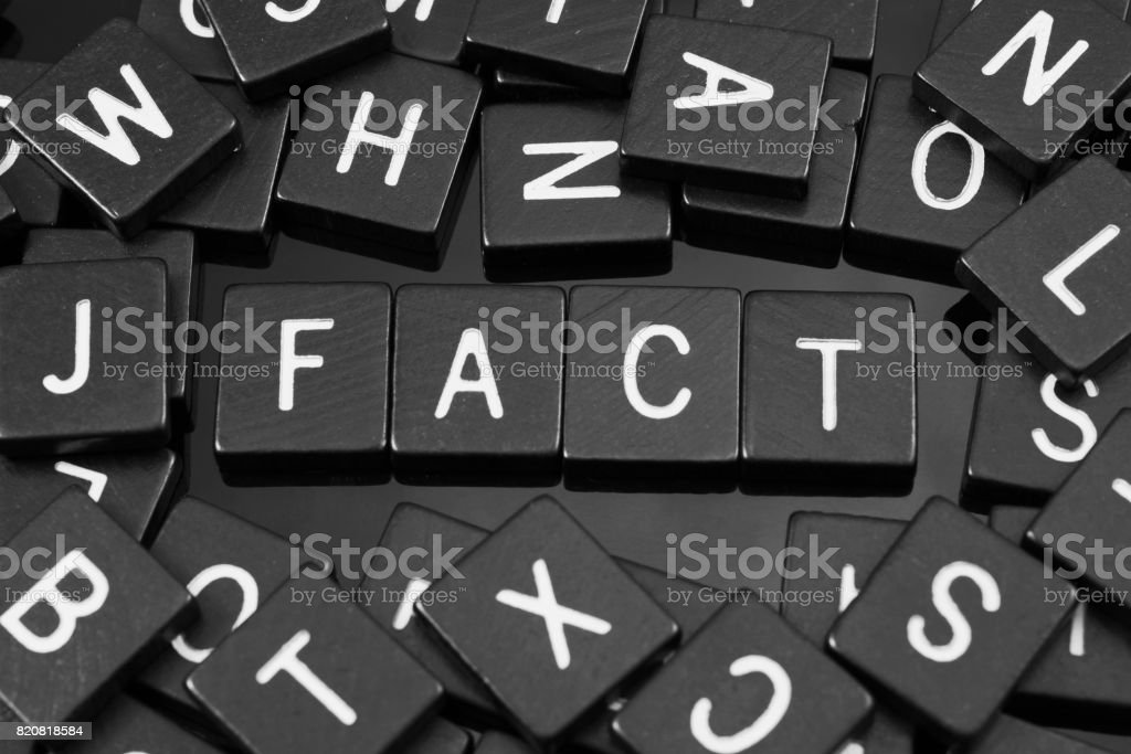 Black letter tiles spelling the word 'fact' stock photo