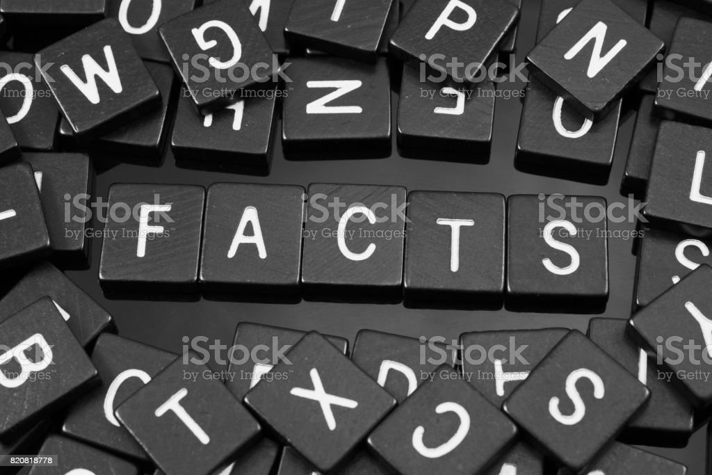 Black letter tiles spelling the word 'facts' stock photo