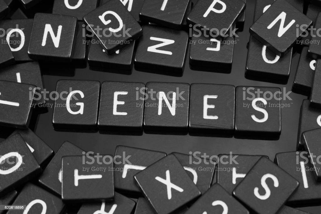 Black letter tiles spelling the word 'genes' stock photo