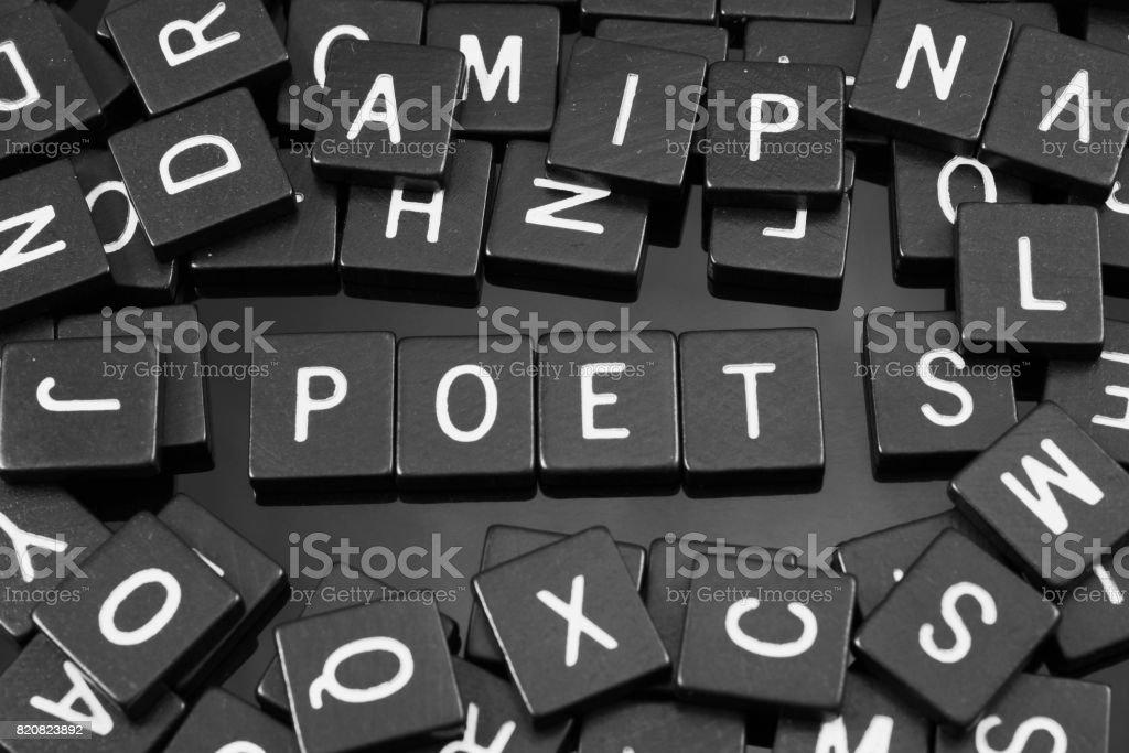 Black letter tiles spelling the word 'poet' stock photo