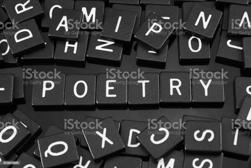 Black letter tiles spelling the word 'poetry' stock photo