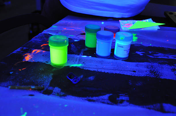 black light party - finger paint cans - fluorescent light stock pictures, royalty-free photos & images