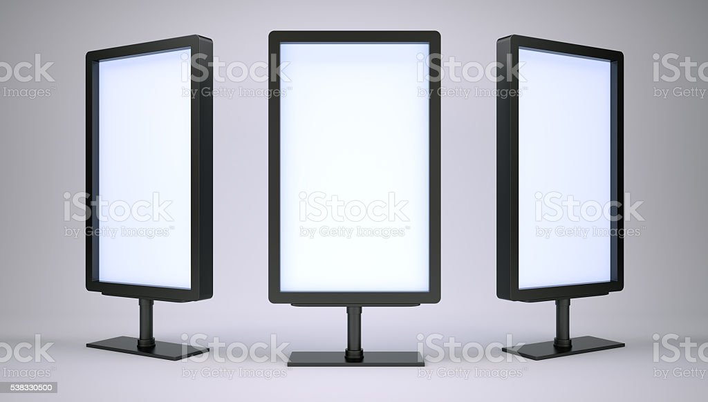 Black lightboxes in empty studio. Front view stock photo