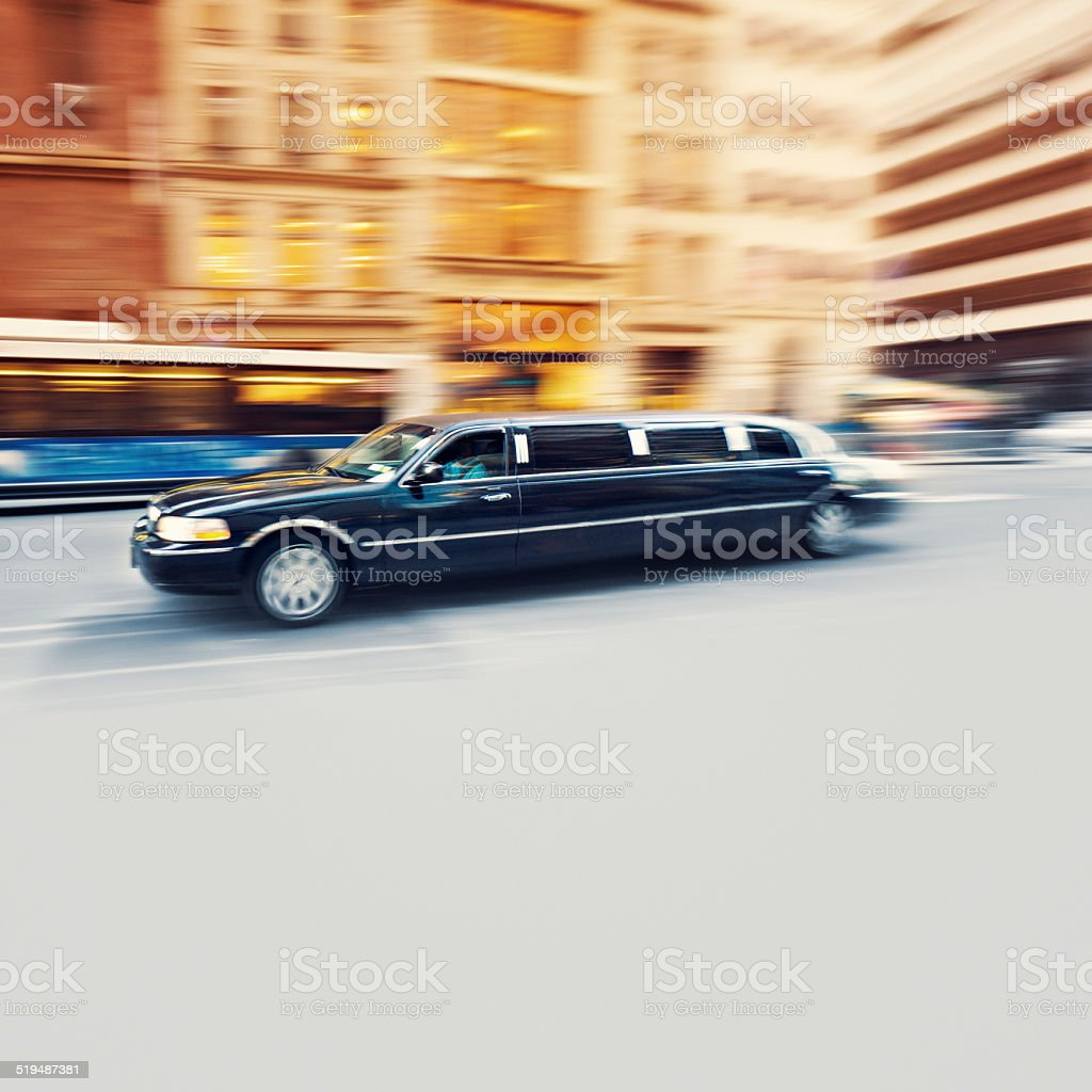 Black Limousine speeding in New York City stock photo