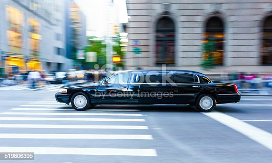 Black Limousine speeding in Manhattan, New York City  - panning motion blur technique