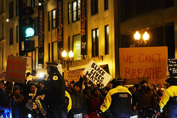 Black Lives Matter Protest Chicago, Illinois, USA - December 7, 2014 - People protest police brutality against African Americans. protest stock pictures, royalty-free photos & images
