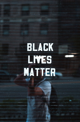 New York, USA - June 15, 2020: Black lives matter sign in downtown Manhattan New York reflecting background