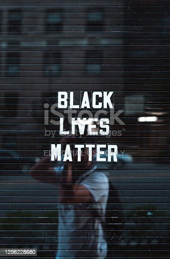 istock Black lives matter sign in downtown Manhattan New York reflecting background 1256228680