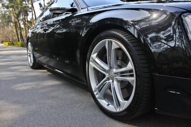 Black luxury car Audi S8 in the city stock photo