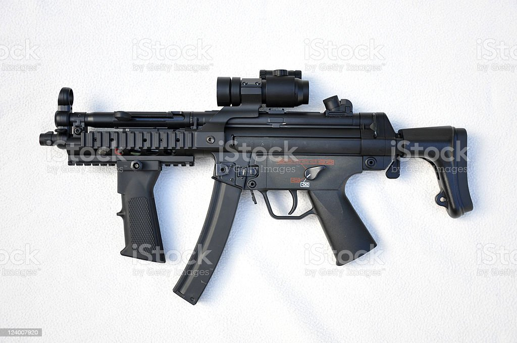 A black machine gun on a white background stock photo