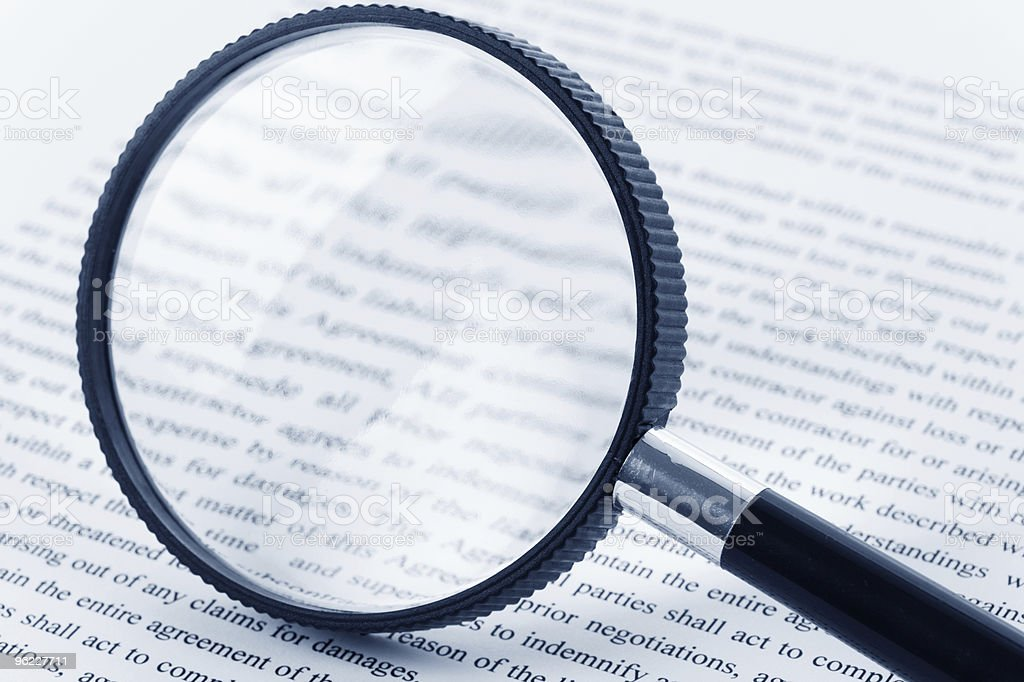 Black Magnifying Glass Over Page Of Book Stock Photo