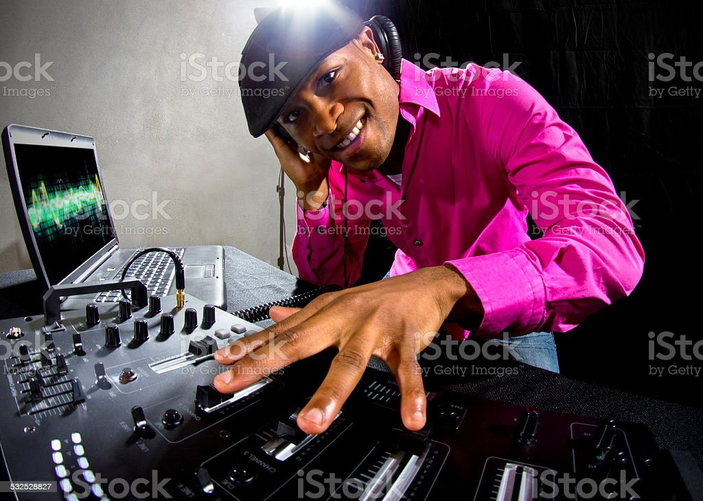 Black Male DJ Playing Music at a Nightclub Party stock photo