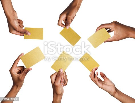 Set of african-american man's hands holding golden empty business or credit cards with copy space. Isolated at white background