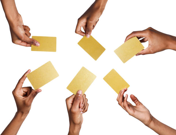 Black male hand with golden business cards. Set, isolated on white. stock photo