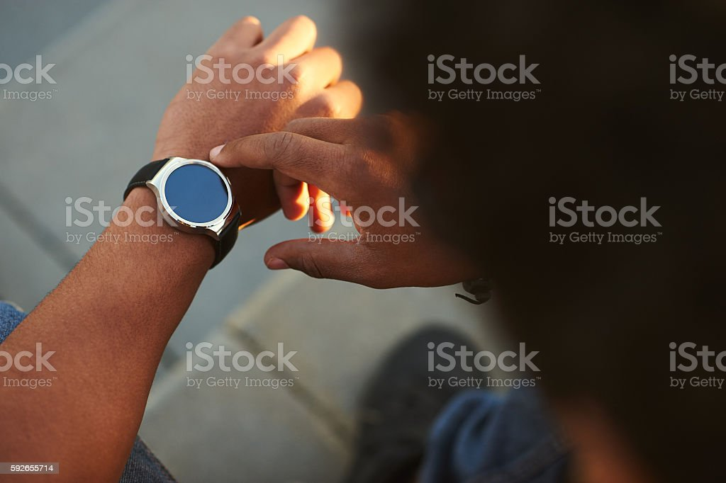 Black Male hand with Smart Watch on wrist stock photo
