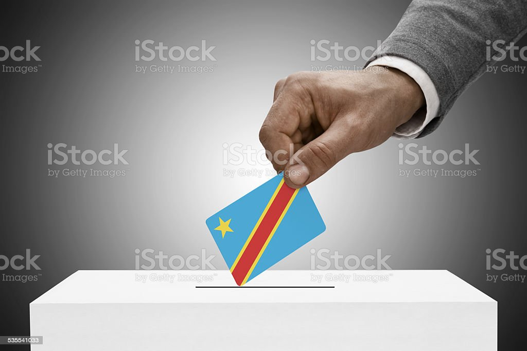 Black male holding flag. Democratic Republic of the Congo stock photo