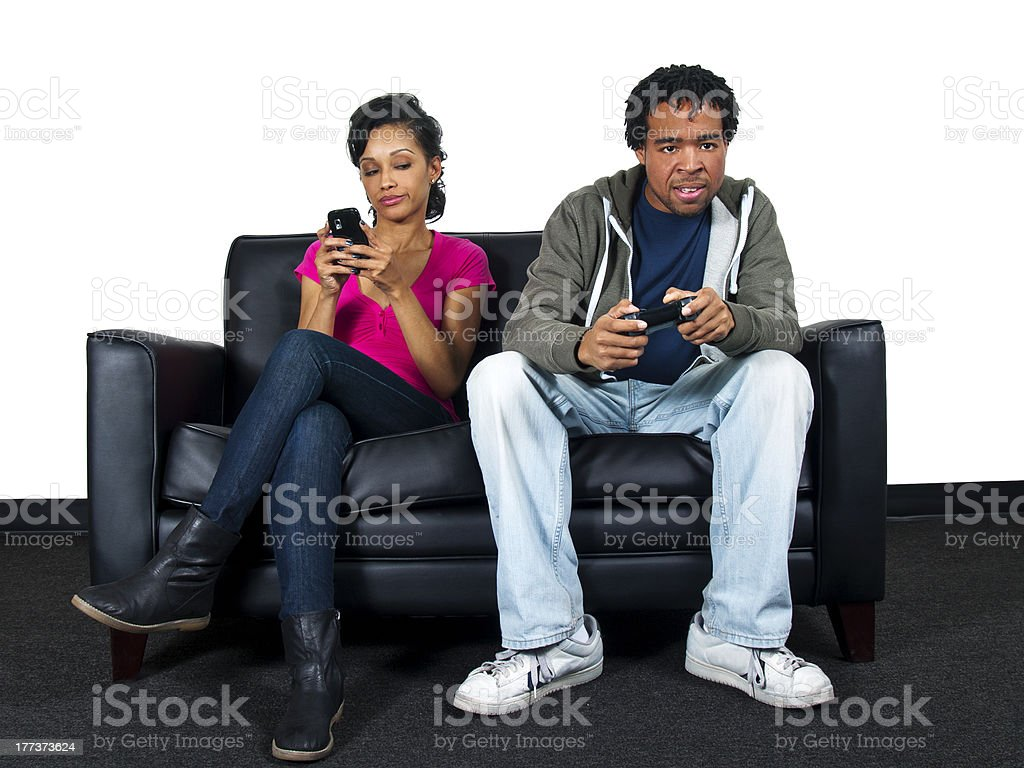 Black Male is Ignoring his Girlfriend While Playing Video Games royalty-free stock photo