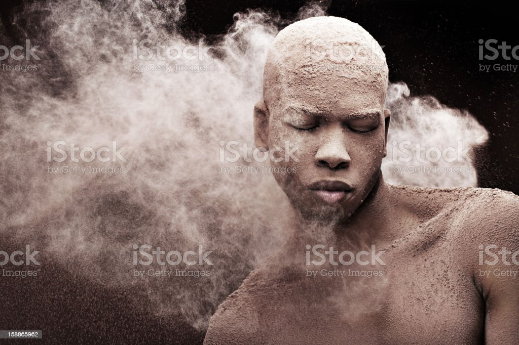 black male model against powder splash royalty-free stock photo