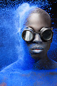 istock black male model covered by blue powder splash 476089210