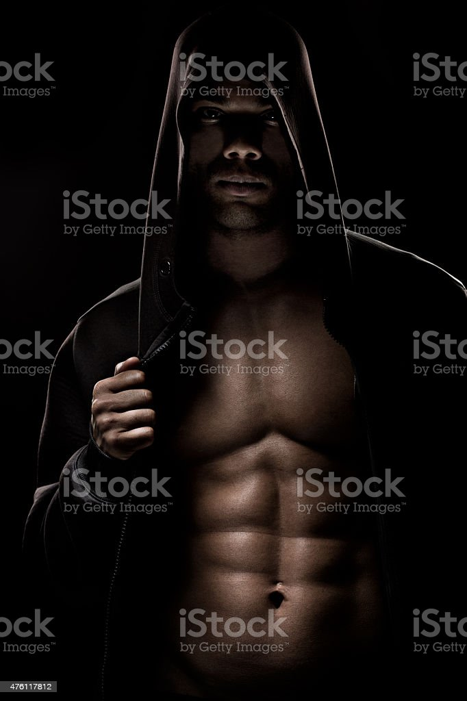 Black male posing in a hooded jacket stock photo