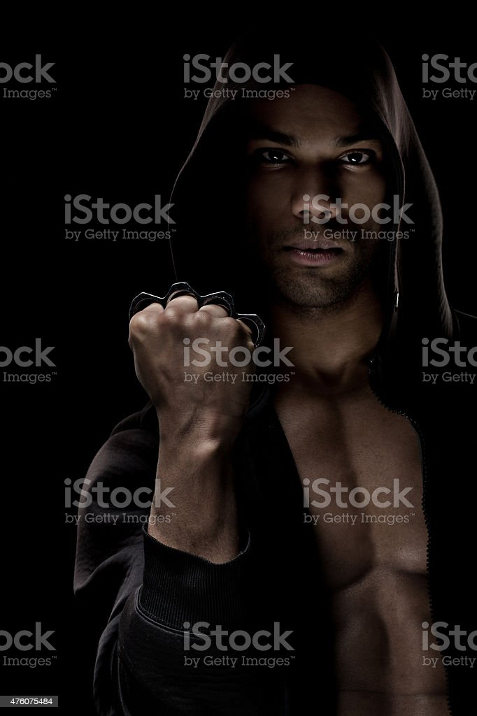 Black male posing with a knuckle duster stock photo