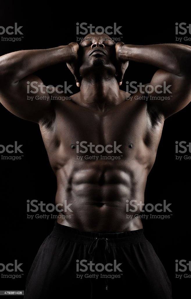 Black male posing with naked torso stock photo